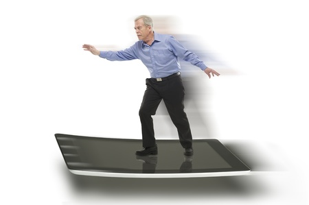 high speed internet: Senior businessman keeping balance on a PC tablet, with blurred motion effect