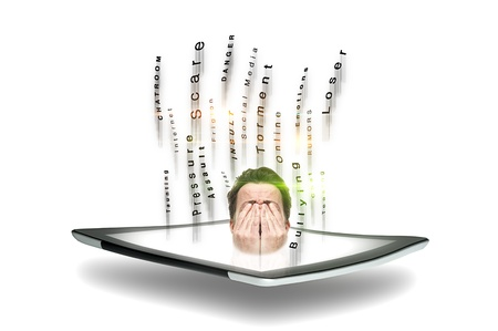 cyber bullying: Conceptual image of a man subject to cyber bullying and predatory online behaviour in chatrooms and forums with his head emitting from a tablet screen covering his eyes surrounded by streaming text