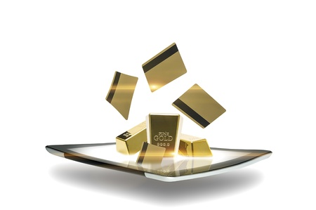 Conceptual image of a modern portable computer tablet with gold bullion bars emitting from the surface of the screen representing online global commodity trade and investment using the gold standard
