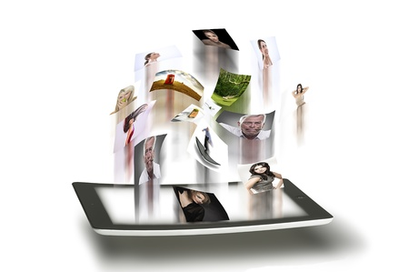 Conceptual photo depicting high speed image transmission with a variety of photographs being emitted from the touchscreen interface of a tablet computer with motion blur photo