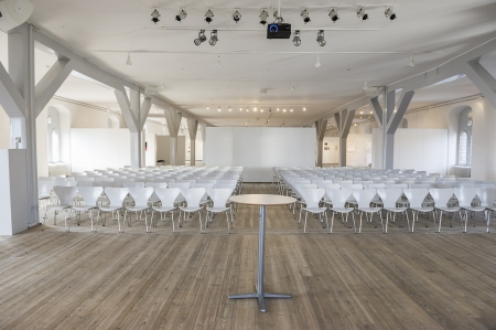 Frontal view from the lecturers perspective of modern modular white seats in a bright airy venue with white painted walls and structural elements Stock Photo - 18832269