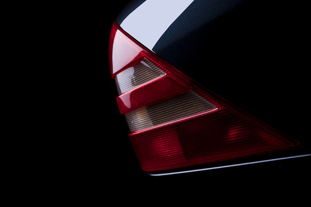 car detail: Luxury Car Rear Tail Light close up on black background Stock Photo