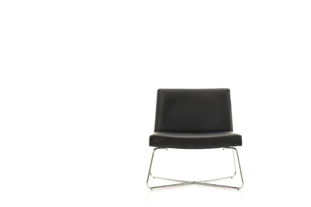 Stylish simple contemporary black chair with crossed metal legs isolated on white, frontal view with copyspace