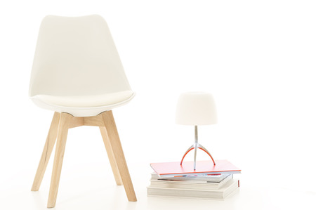 lampshade: Furniture Still Life Modern White Chair and Lamp on Stack of Books in White Studio Space