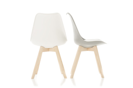 modular home: Conceptual Empty White Wooden Leg Chairs Isolated on White Background. Stock Photo