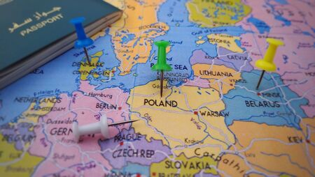 Pushpin marking on Poland on travel map with passport, travel concept 版權商用圖片