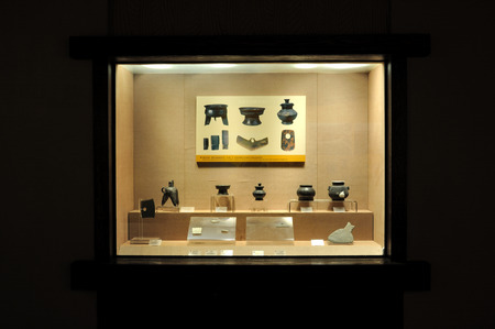 antique booth: collection of ancient antique displaying in a museum Editorial