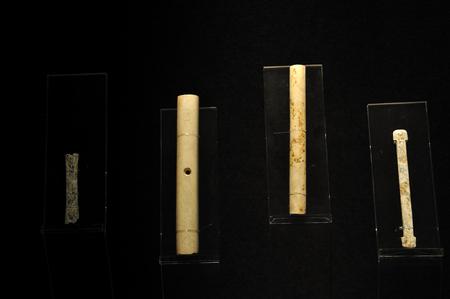 bar ware: Jade long tube displaying in a museum