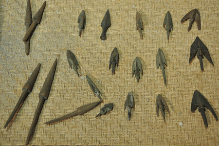 antiquarian: ancient archery arrows in museum Editorial