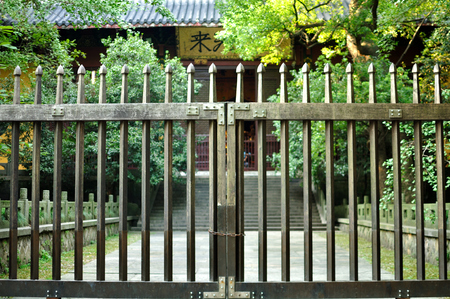 metal gate: Metal gate in front of a Chinese temple