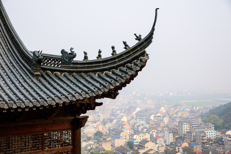 olden day: Little figurines on top of an ancient chinese building roof