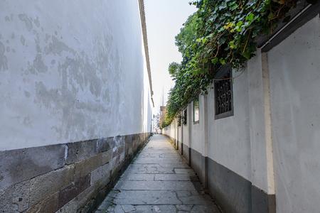 enclosing: enclosing wall with pathway