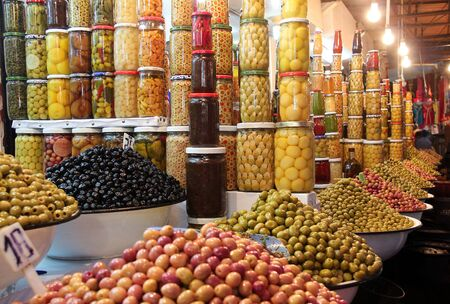 Long way with thousands of olives on a market. Stockfoto