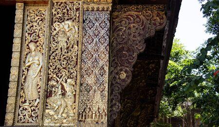Beautiful golden wall ornaments near Wat Xieng Thong, Luang Prabang, Laos, south-east Asia.