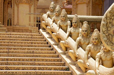 Golden statues near the stairs in front of the Golden Temple in Phnom Penh, Cambodia, south-east Asia.