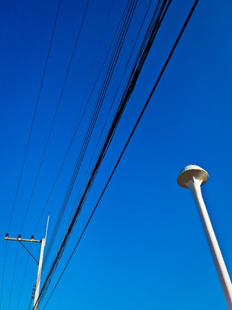 electricity post and Water tank in blue sky photo