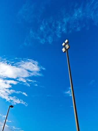 Poles Spotlights with blue sky and cloud photo