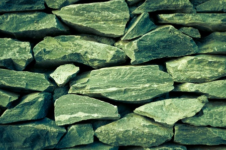 Texture of old stone wall  in the garden Stock Photo