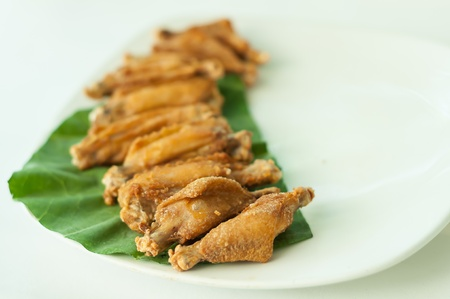 Chicken wings fried on white Dish with nature light Stock Photo