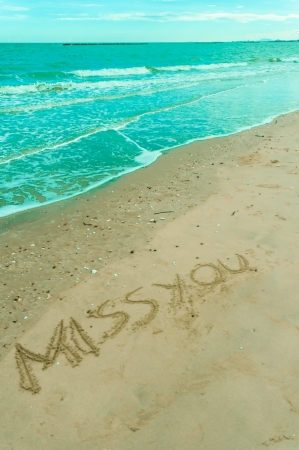 missyou written in sand on a beach Stock Photo - 13913630