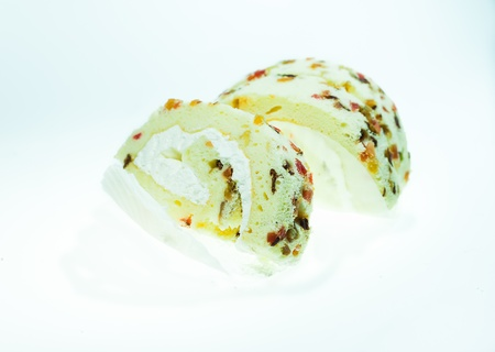 Fruit yam roll cake isolated on white background photo