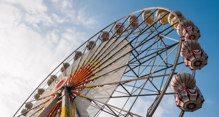 ferris wheel against a blue sky and cloud photo
