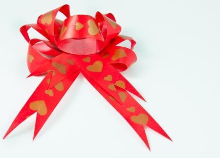 ribbin: Red bow ribbon on white background pattern heart Stock Photo