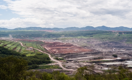 lanscape: Lanscape of coalmine with cloudy and mountain in daylight time Stock Photo