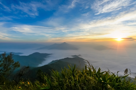 Sunrise at horizon in morning time on mountain with blue sky cloudy and fog photo