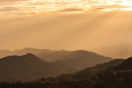 Sunbeam on mountain landscape and misty