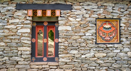 Window and logo of korea style in stone wall photo