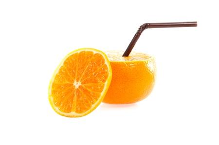 Orange with straw on white background isolate Stock Photo