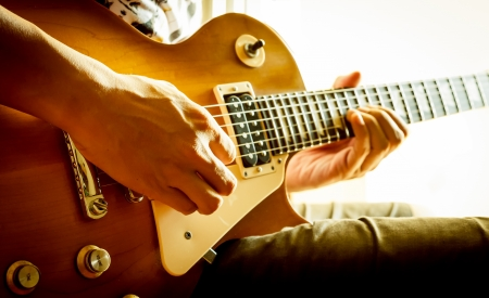 man playing electric guitar with nature light Stock Photo