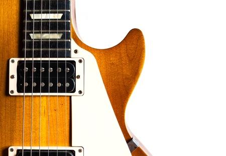 Old electric guitar humbucker pickup honey burst color on white background isolate photo