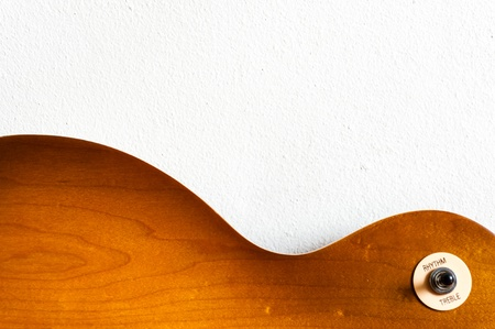 Pattern wood of electric guitar honey burst color with texture of white wall photo