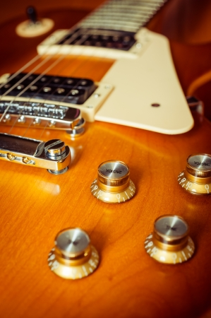Electric guitar honey burst color on floor with knob control Stock Photo - 14980623