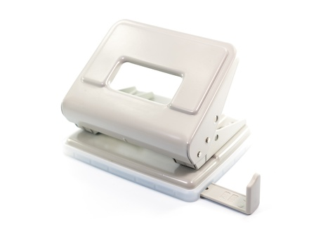 paper puncher: Paper puncher on white background isolate