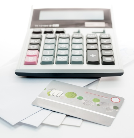 Credit card and Calculator on white Envelope isolate white background photo