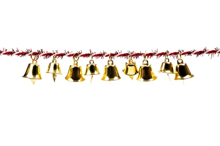 Golden bell holding ribbon rope moving isolate on white background photo