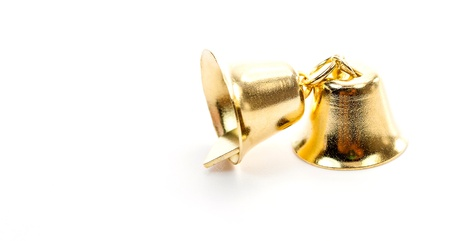 Golden bell isolate on white background Stock Photo