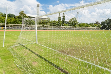 Soccer goal net in football field grass in stadium photo