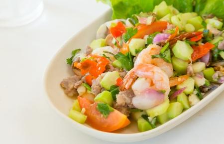thai food kale with prawn salad on white table