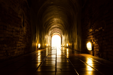 near death: Light at End of Old Brick Tunnel Stock Photo