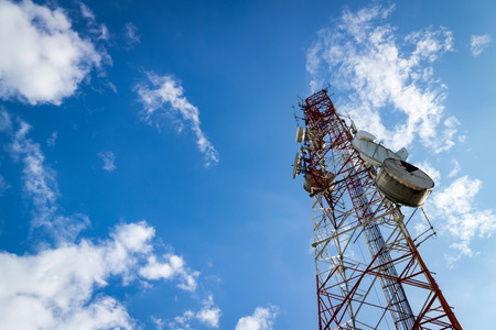 Communications Tower with cloud and blue sky Stock Photo