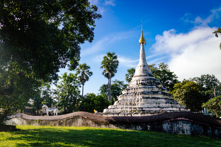 old white pagoda famous place travel in nan province of thailand with sunlight