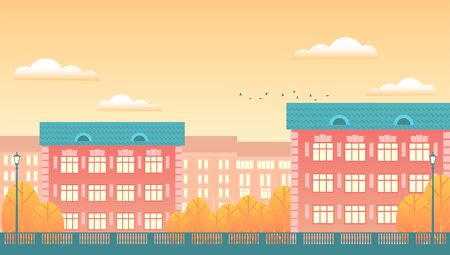Background of the autumn city. Residential buildings, yellow trees, patterned fencing, clouds in the sky. Vector flat illustration in the form of a banner.
