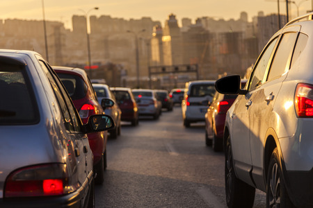 end of the day: Evening traffic. Drivers who wait in traffic to go home from work at the end of the day. Stock Photo
