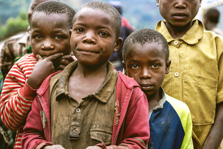eye traveller: Byumba, Rwanda, Africa - September 6, 2015: Unidentified the African kids. They seem poor in their old clothes and they look with hopeful eyes.