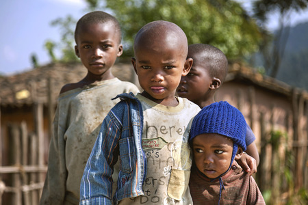 strangers: Ruhengeri, Rwanda, Africa - September 9, 2015: Unidentified children. The African boy hugs his brother who feared the strangers around and make him feel safe. Editorial