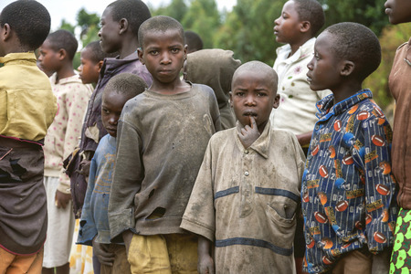african solidarity: Kigali, Rwanda, Africa - September 6, 2015: Unknown the African children. Two of them look into camera, the others look another sides. All clothes of them are torn and dirty.